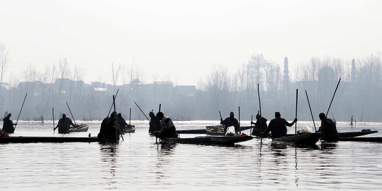 Fishermen work to catch fish using Pazars in the middle of Anchar Lake in Srinagar, Jammu and Kasmir, on Feb. 16.