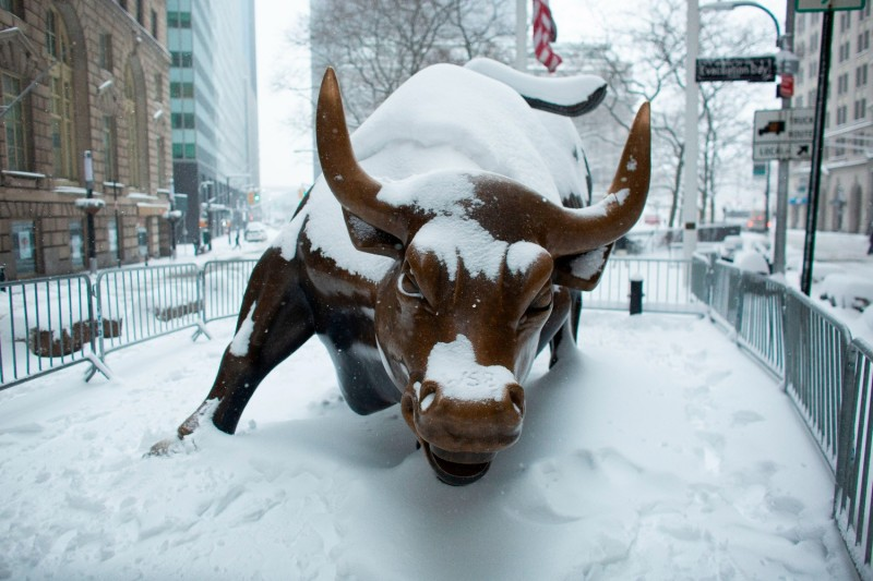 The Charging Bull Statue is covered by snow in Lower Manhattan during a winter storm on Feb. 1, 2021 in New York City.