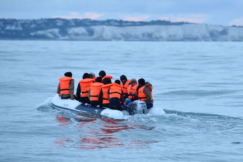 Migrants in a dinghy navigate in the English Channel toward the south coast of England after crossing from France, on Sept. 1, 2020.