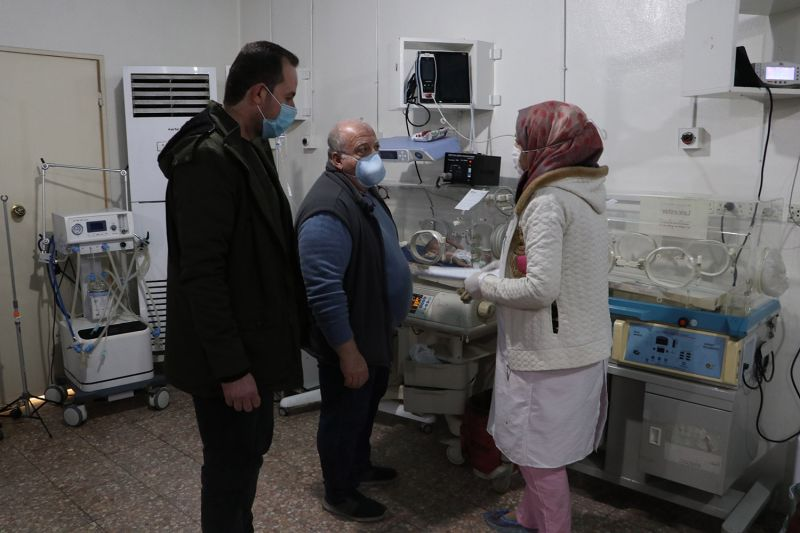 Mufaddal Hamaddeh (center) works with a Syrian American Medical Society neonatal intensive care nurse and medical field officer at Ibn Sina Hospital in Idlib, Syria, on Feb. 9.