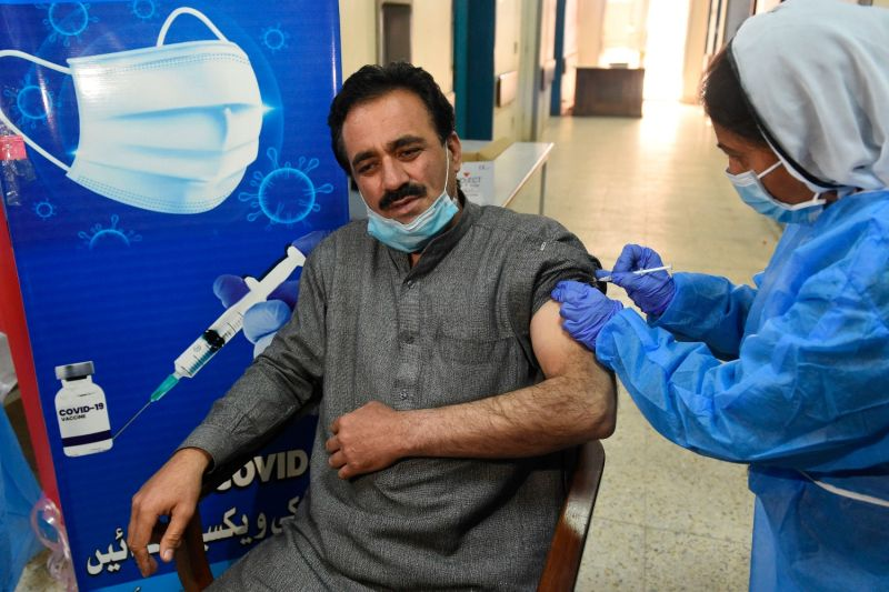 A doctor receives a dose of the Chinese-made Sinopharm COVID-19 vaccine at a vaccination center in Quetta, Pakistan, on Feb. 3.
