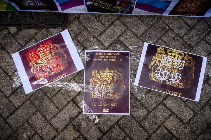 Defaced photocopies of British National Overseas passports are displayed by pro-Beijing activists as they gather outside the British Consulate General to protest against the use of BNO passports in Hong Kong on Feb. 1.