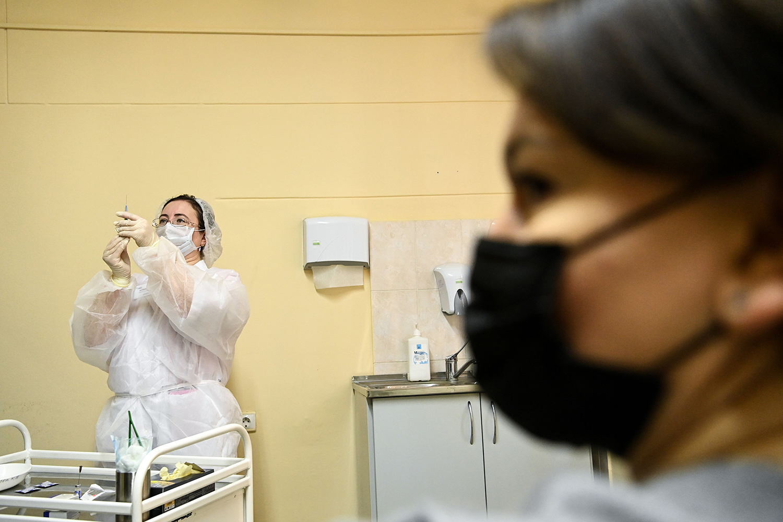A nurse prepares a Sputnik V coronavirus vaccination at a clinic in Moscow on Dec. 5, 2020.