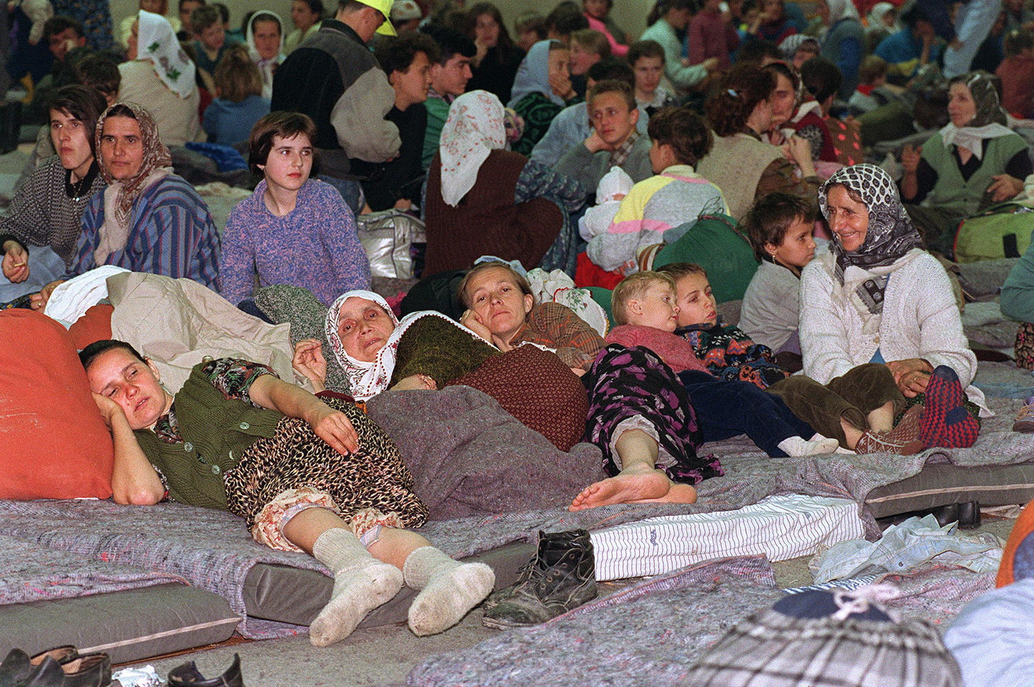 Refugees from Srebrenica crowd a local sport hall in Tuzla on April 14, 1993.