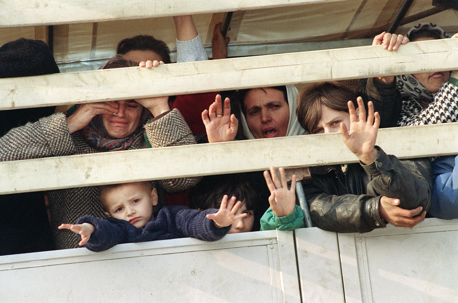 Refugees ride a United Nations truck as they flee the Serb-besieged Bosnian enclave of Srebrenica for Tuzla on march 31, 1993.