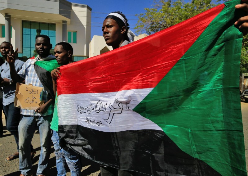 Sudanese demonstrators protest outside the Foreign Ministry in Khartoum