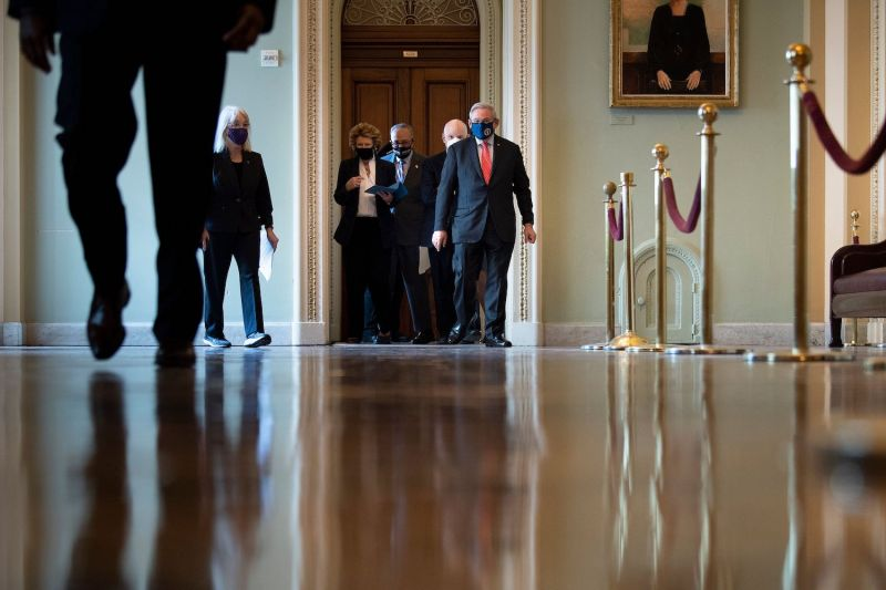 Senate Majority Leader Chuck Schumer walks with Democratic lawmakers on Capitol Hill in Washington on Feb. 9.