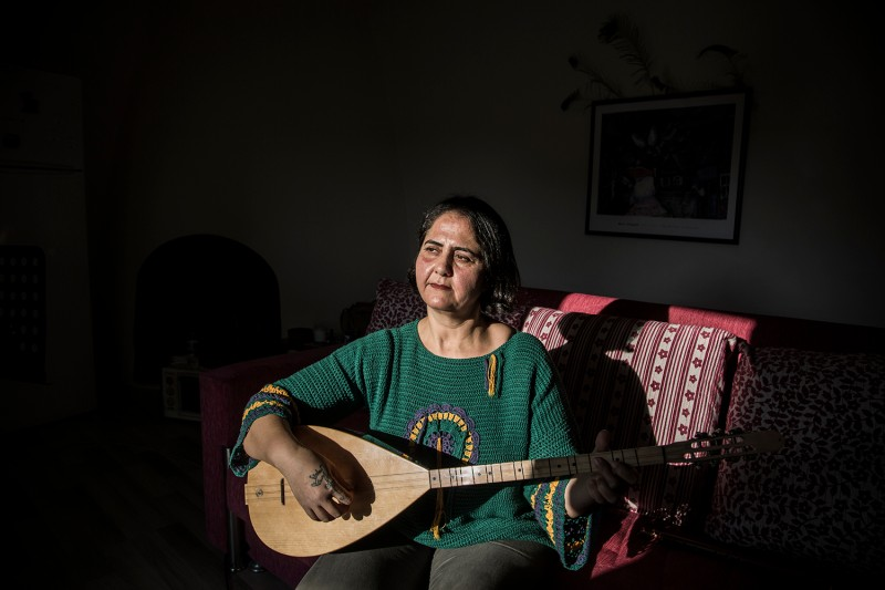 Yeliz Guzel practices her musical instrument, the baglama—a kind of lute, in her one-room apartment in Mersin, Turkey, on Nov. 23, 2020.