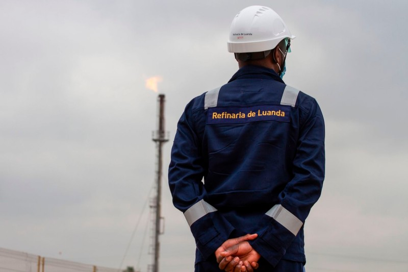 An employee of Angola's national oil company, Sonangol, wears a protective helmet at the Sonangol Luanda Refinery on Oct. 22, 2020.