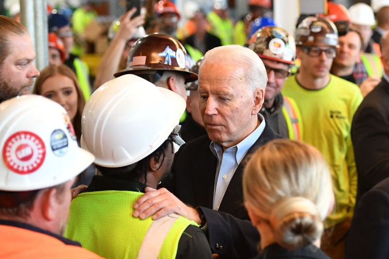 Then-presidential candidate Joe Biden meets workers at the Fiat Chrysler plant in Detroit on March 10, 2020.