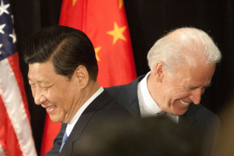 Then-Chinese Vice President Xi Jinping and then U.S.-Vice President Joe Biden attend a luncheon in Los Angeles on Feb. 17, 2012.
