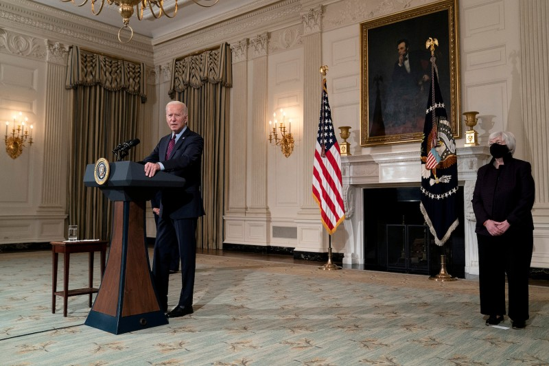 Treasury Secretary Janet Yellen, right, listens as President Joe Biden speaks about the economy in the State Dining Room of the White House in Washington on Feb. 5.