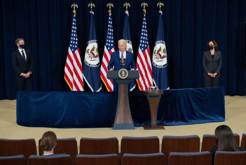 U.S. President Joe Biden, with U.S. Secretary of State Antony Blinken  and U.S. Vice President Kamala Harris, speaks to the staff of the State Department  in Washington, DC, February 4, 2021.