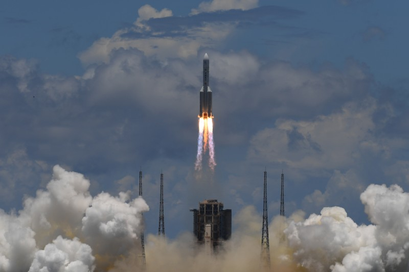 A Long March 5 rocket carrying an orbiter, lander, and rover destined for Mars lifts off from the Wenchang Spacecraft Launch Site in Hainan province, China, on July 23, 2020.
