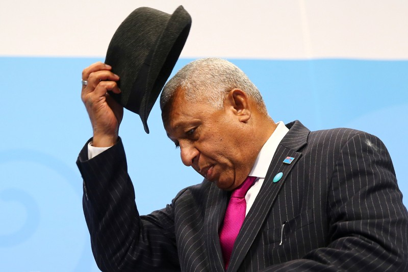 Fiji Prime Minister Frank Bainimarama takes off his hat at the start of the final session of the U.N. Climate Change Conference hosted by Fiji and held in Bonn, Germany, on Nov. 18, 2017.