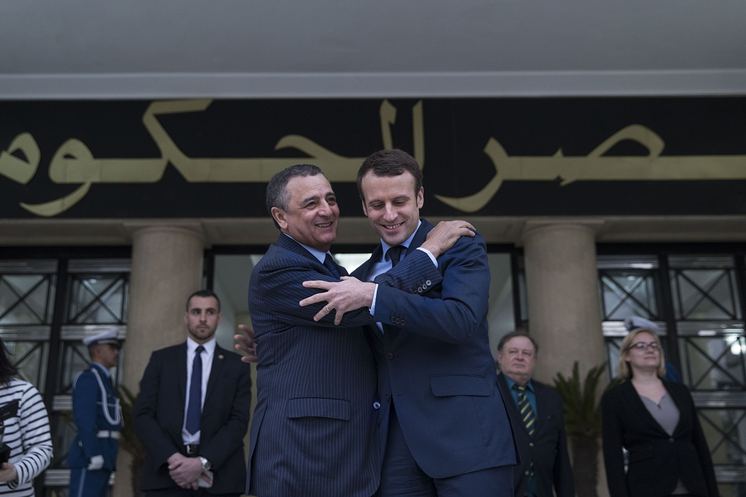 Then French Economy Minister and presidential candidate Emmanuel Macron greets Algerian Minister of Industry and Mining Abdeslam Bouchouareb in Alger, Algeria, on Feb. 13, 2017.