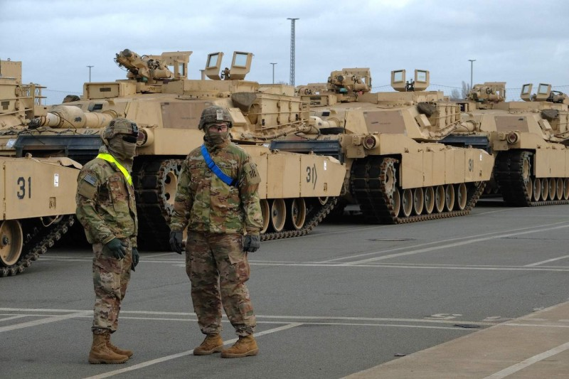 Military personnel unload M1 Abrams tanks ahead of a U.S.-led military exercise with NATO allies in Bremerhaven, Germany, on Feb. 21, 2020.