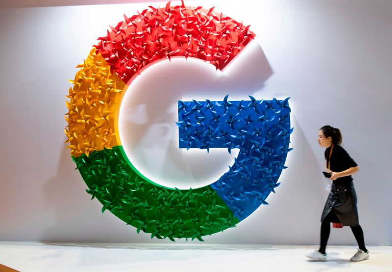 A woman passes the Google booth at the China International Import Expo in Shanghai on Nov. 5, 2018.