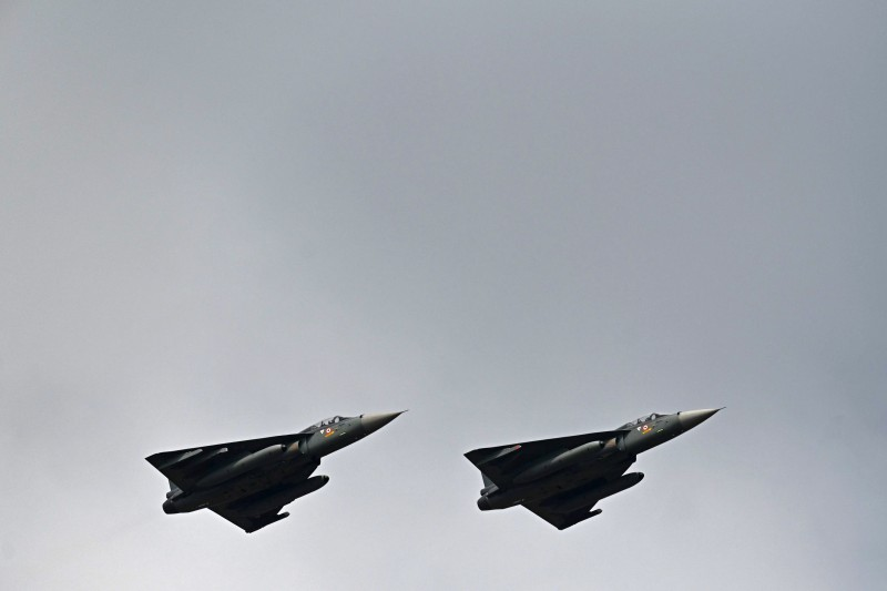 Indian Air Force Tejas fighter jets perform at the Aero India air show at Yelahanka Air Force Station in Bangaluru, on Feb. 3.