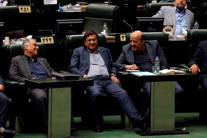 Abdolnaser Hemmati (C), Governor of the Central Bank of Iran, listens to a speech in parliament in Tehran on Oct. 7, 2018.