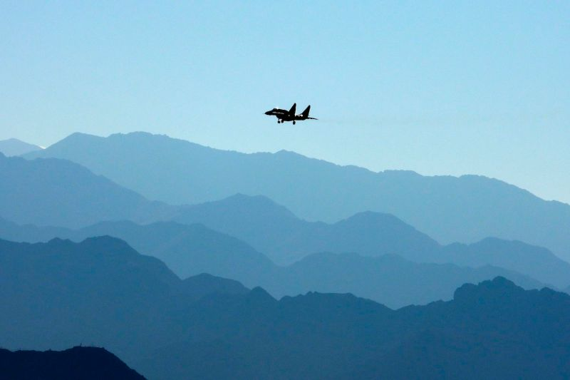 An Indian Air Force fighter jet flies over a mountain range in Leh, India, the joint capital of the union territory of Ladakh bordering China, on Sept. 15, 2020.