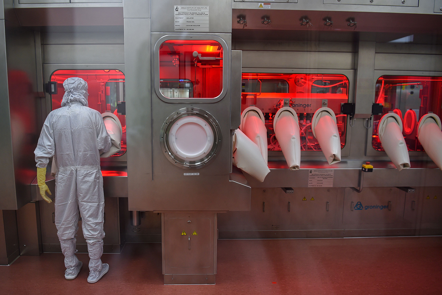 An employee works on an assembly line for manufacturing vials of Covishield, AstraZeneca-Oxford's COVID-19 vaccine at India's Serum Institute in Pune, India, on Jan. 22.