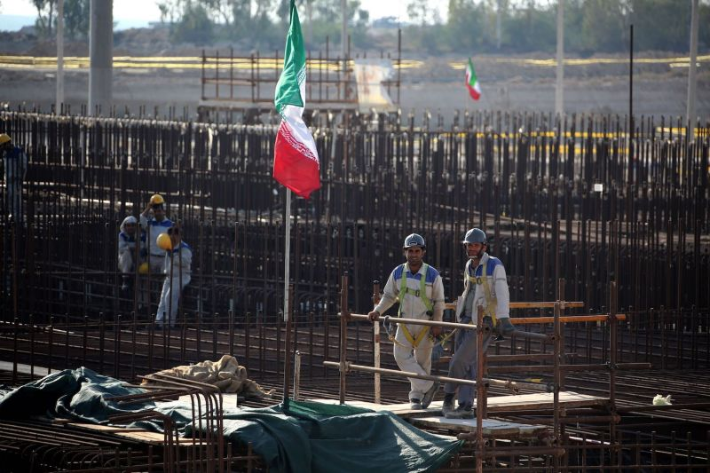 A picture taken on Nov. 10, 2019, shows workers on a construction site at Iran's Bushehr nuclear power plant.