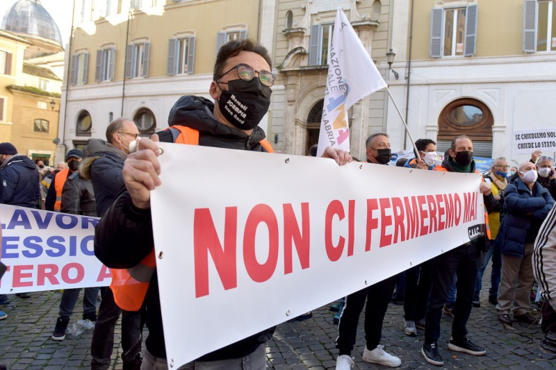 Street vendors, market traders, and self-employed workers from across Italy protest to push for relief from the crisis caused by the coronavirus pandemic in Rome on Feb. 11.