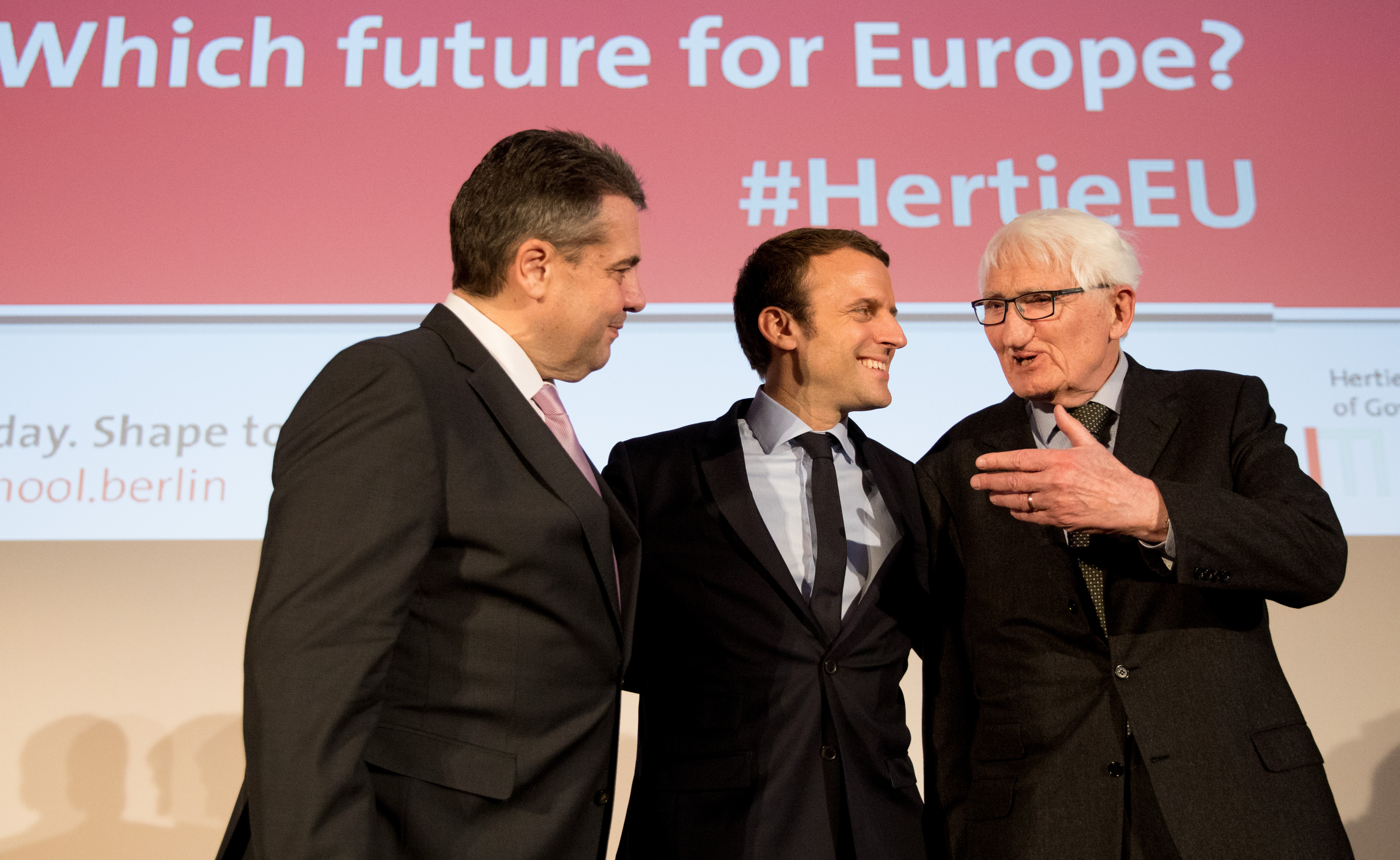 Emmanuel Macron, then a candidate for French president, and German Foreign Minister Sigmar Gabriel talk with Habermas at the Hertie School of Governance in Berlin on March 16, 2017.