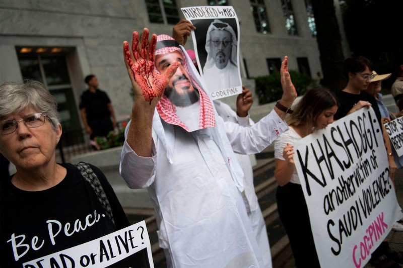A demonstrator dressed as Saudi Arabian Crown Prince Mohammed bin Salman with blood on his hands