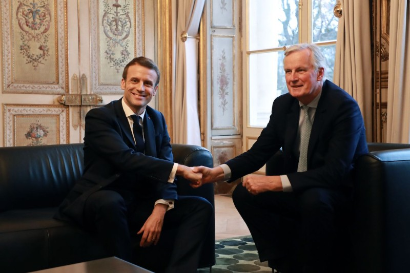 French President Emmanuel Macron shakes hands with then-European Commission Chief Negotiator Michel Barnier prior at the Elysée palace in Paris, on January 31, 202.