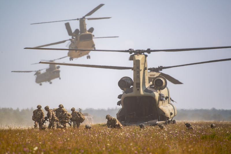 Troops of the U.S. 173rd Airborne Brigade disembark from Chinook CH-47 helicopters during military exercises near Hohenfels, Gerrmany, on Aug. 10, 2020.