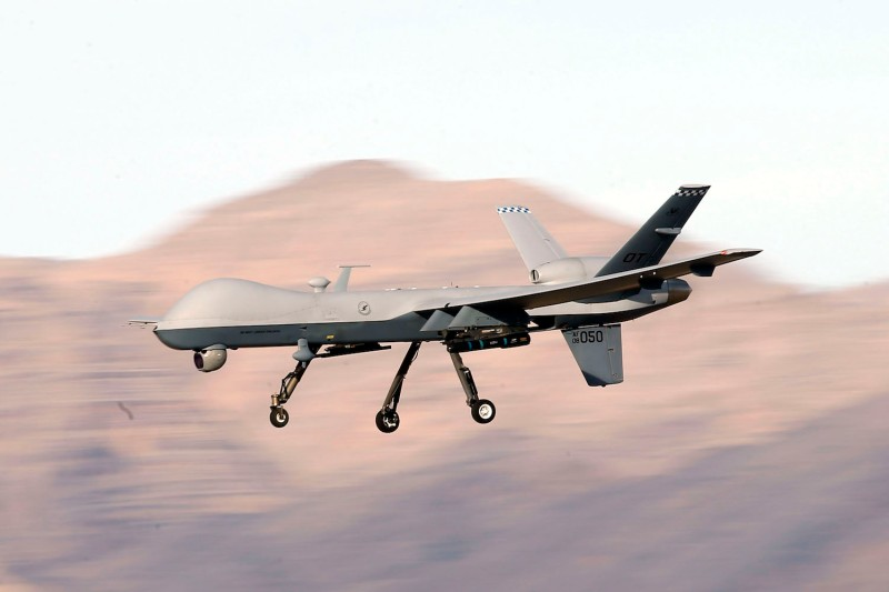 An MQ-9 Reaper remotely piloted aircraft flies by during a training mission at Creech Air Force Base in Indian Springs, Nevada, on Nov. 17, 2015.