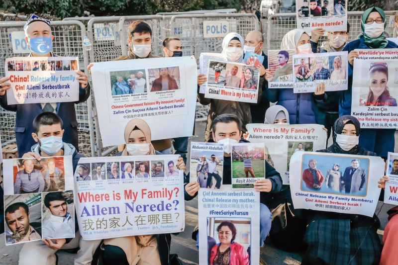 Muslim Uighurs hold placards as they demonstrate in front of the Chinese Consulate in Istanbul after China announced the ratification of an extradition treaty with Turkey on Dec. 30, 2020.