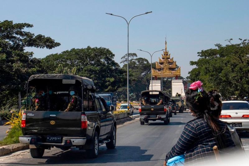 Military vehicles are seen along a road in Mandalay, Myanmar, on February 2, 2021.