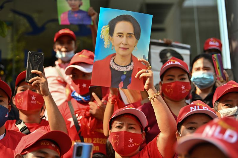 Myanmar residents in Thailand hold up portraits of State Counsellor Aung San Suu Kyi during a demonstration outside the Myanmar embassy in Bangkok on Feb. 1.