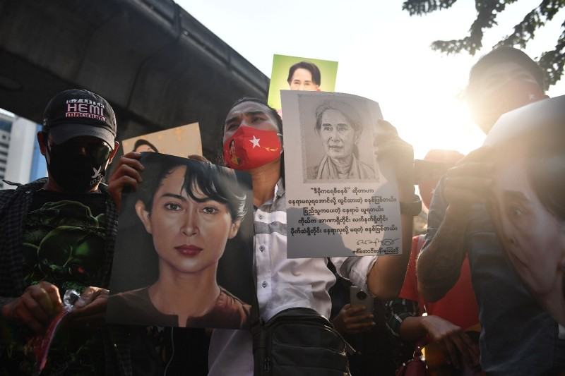 Myanmar migrants hold up portraits of Aung San Suu Kyi, Myanmar's de facto leader who was recently detained by the military in a coup, as they take part in a demonstration outside the Myanmar Embassy in Bangkok on Feb. 1.