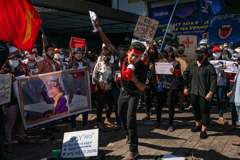 A protest leader shouts slogans through a megaphone on Feb. 9 in Yangon, Myanmar.