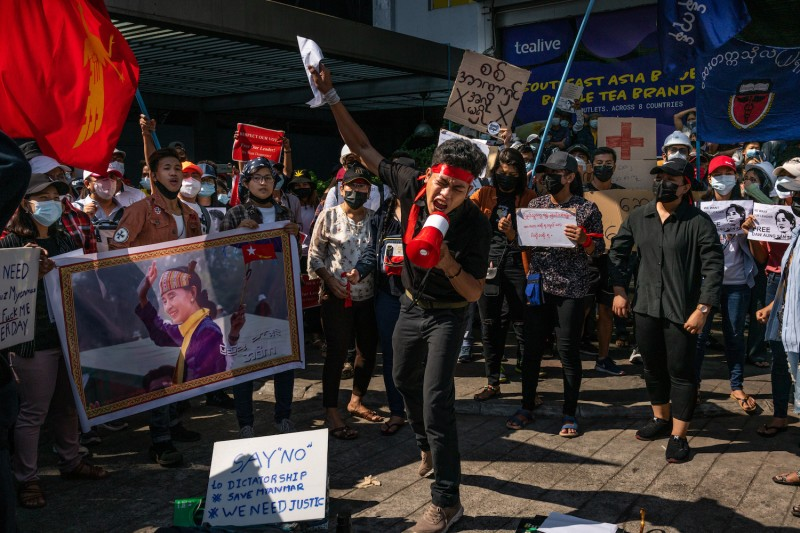 A protest leader shouts slogans through a megaphone on Feb. 9 in Yangon, Myanmar.