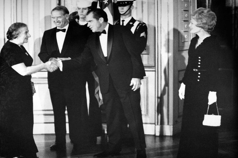 Israeli Prime Minister Golda Meir (L) is greeted upon her arrival in the Blue Room of the White House by U.S. President Richard Nixon and his wife Pat  on Oct. 24, 1970.