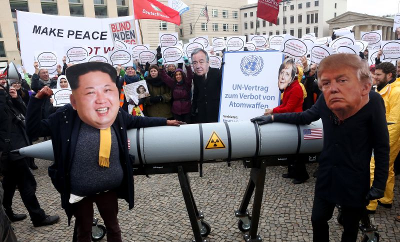 Activists with masks of North Korean leader Kim Jong Un and U.S. President Donald Trump protest against nuclear weapons in Berlin on Nov. 18, 2017.