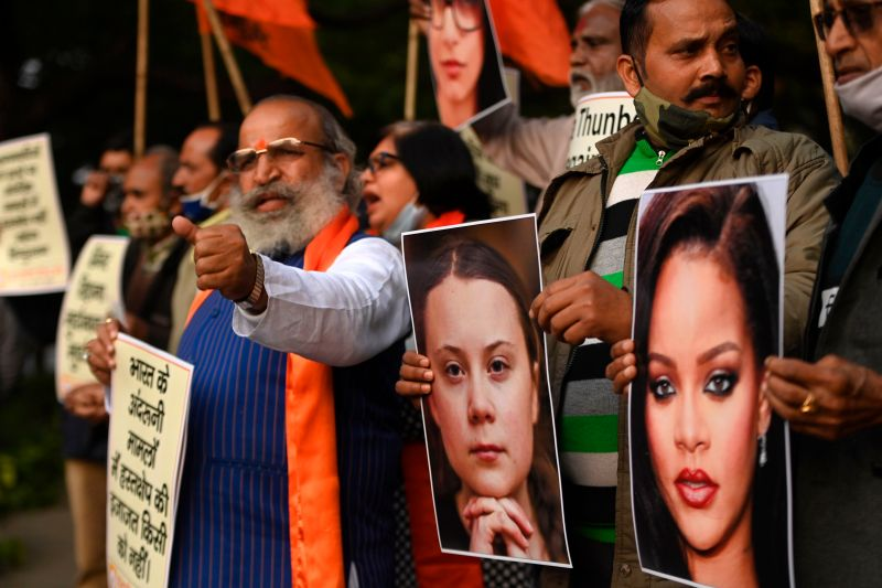 Activists of the United Hindu Front hold pictures of Swedish climate activist Greta Thunberg and Barbadian singer Rihanna in New Delhi on Feb. 4.