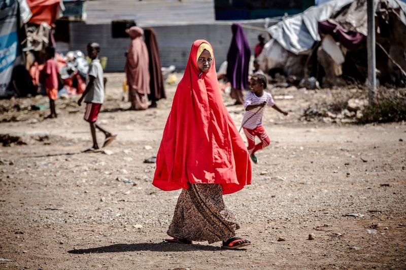 A girl walks toward her tent at a displacement camp for people affected by intense flooding in Beledweyne, Somalia, on Dec. 14, 2019.