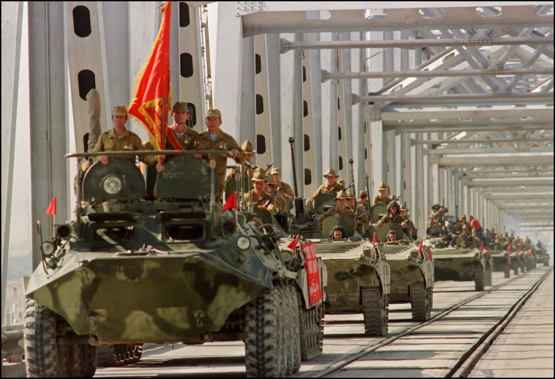A convoy crosses a bridge in Termez, now part of Uzbekistan, during the withdrawal of the Soviet Red Army from Afghanistan, on May 21, 1988.