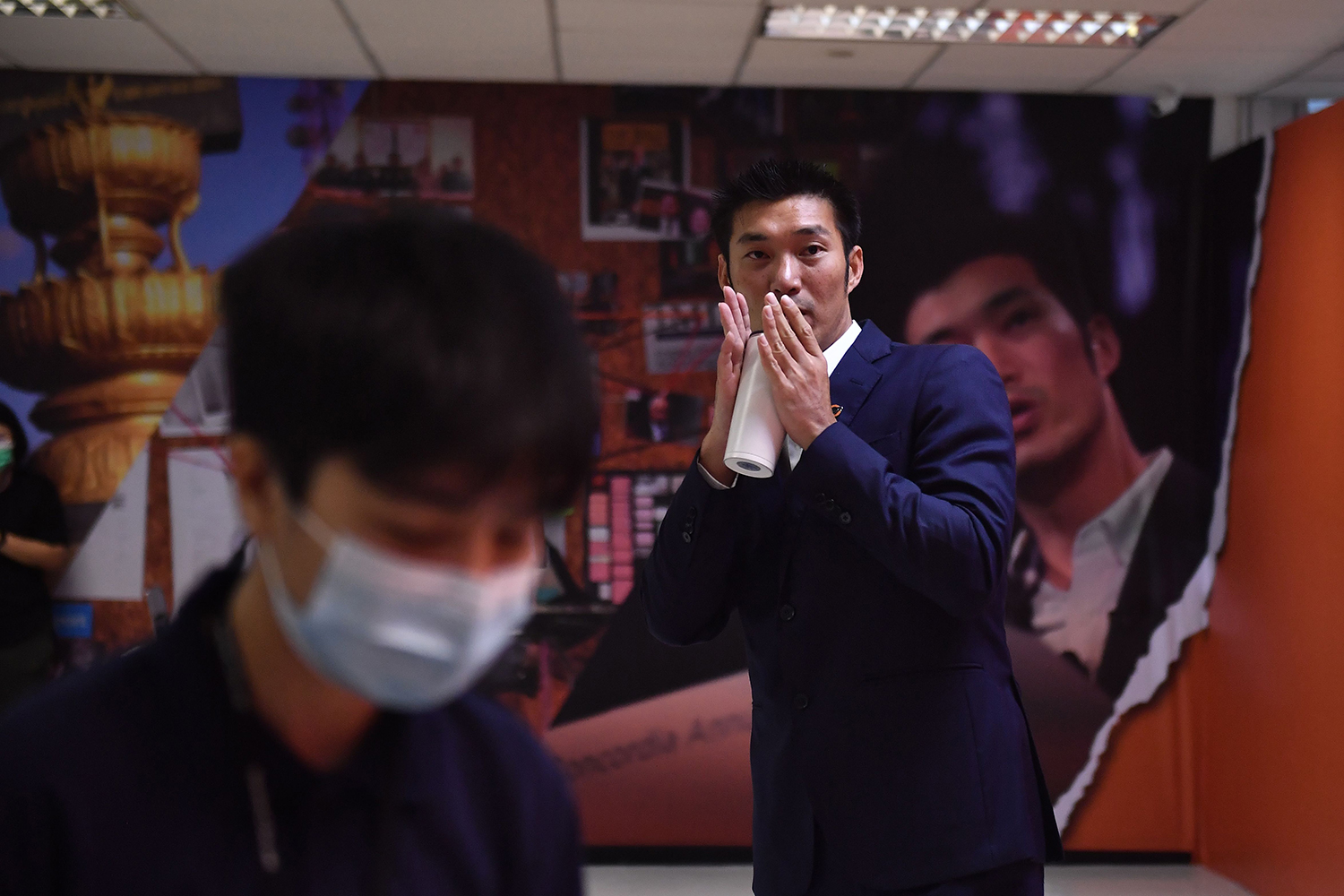 Thanathorn Juangroongruangkit gestures as he leaves a news conference in Bangkok on Jan. 21 after he was accused of contravening Thailand's strict royal defamation laws by posting a video criticizing the government's COVID-19 vaccine strategy.