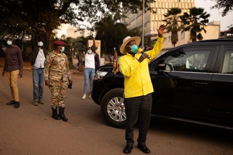 Ugandan President Yoweri Museveni stops to speak to supporters as he heads back to his residence in Kampala, Uganda, on Jan. 21.