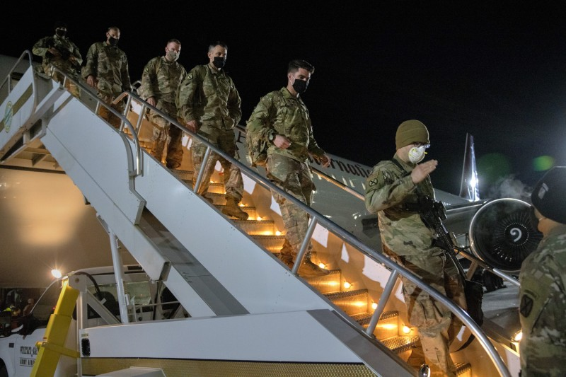 U.S. Army soldiers from the 10th Mountain Division arrive home from a 9-month deployment in Afghanistan on Dec. 8, 2020 at Fort Drum, New York.