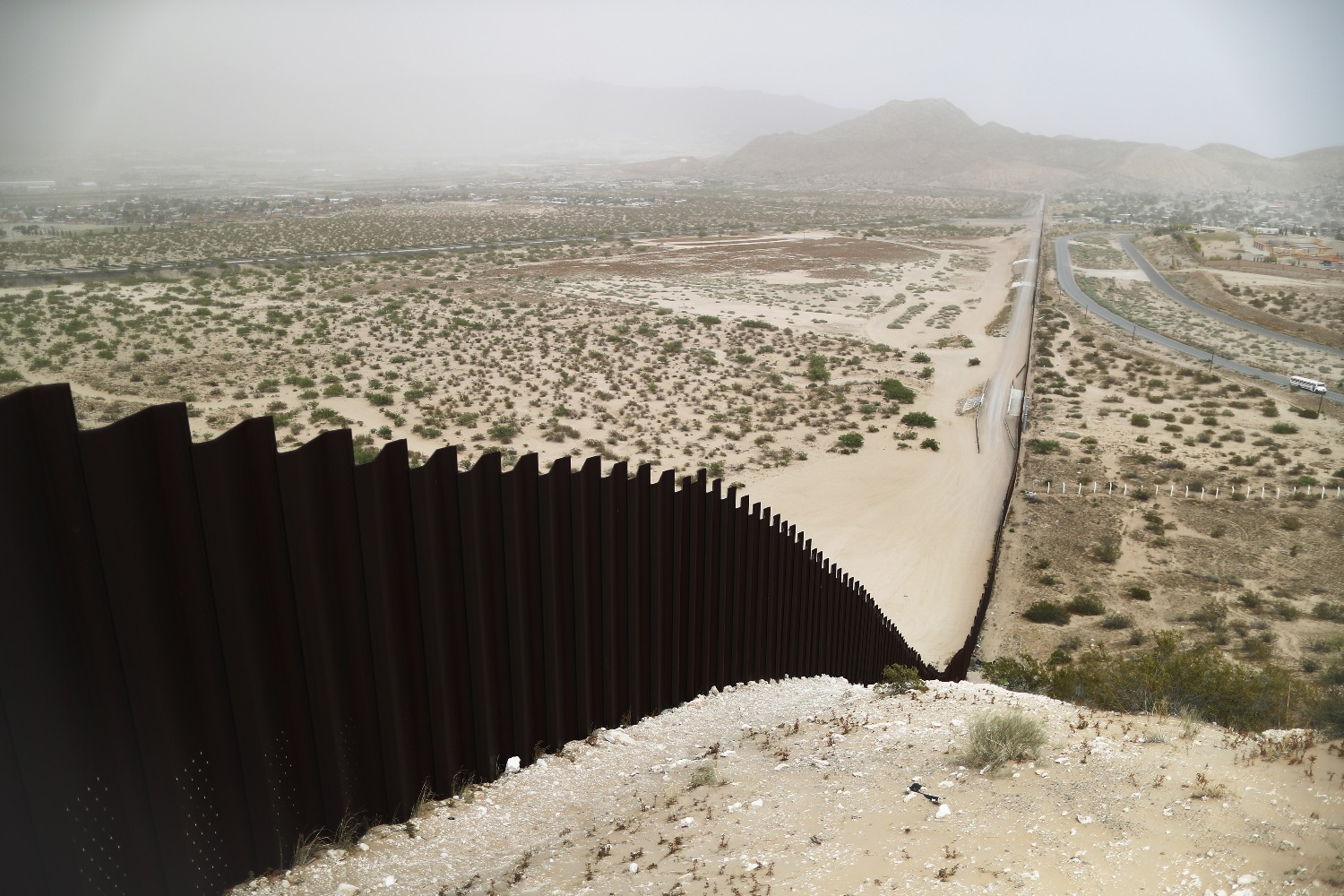 The border barrier between the United States (left) and Mexico as taken from Ciudad Juárez, Mexico, runs down a hillside on May 20, 2019.