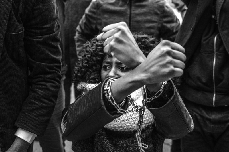 A woman's hands are chained as a sign of protest in Spain.