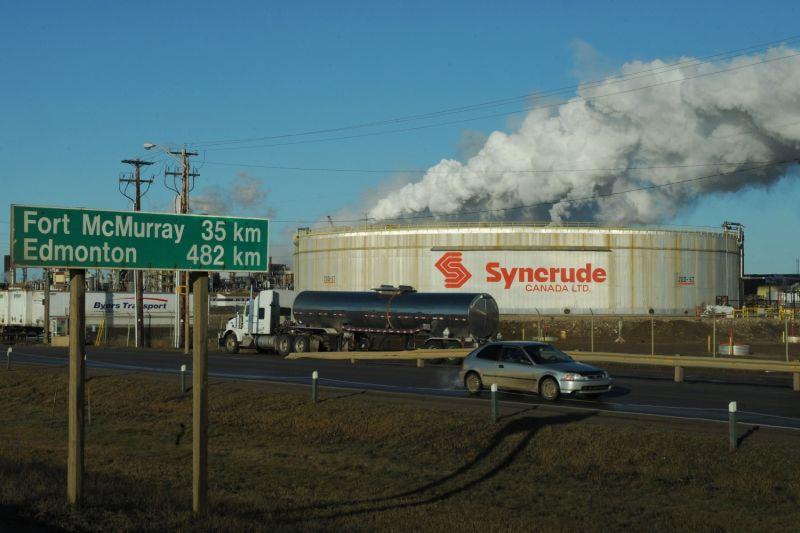 An oil facility pumps smoke.